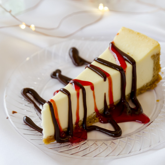 """""""Cheesecake slice with drizzled sauce"""" stock image"""