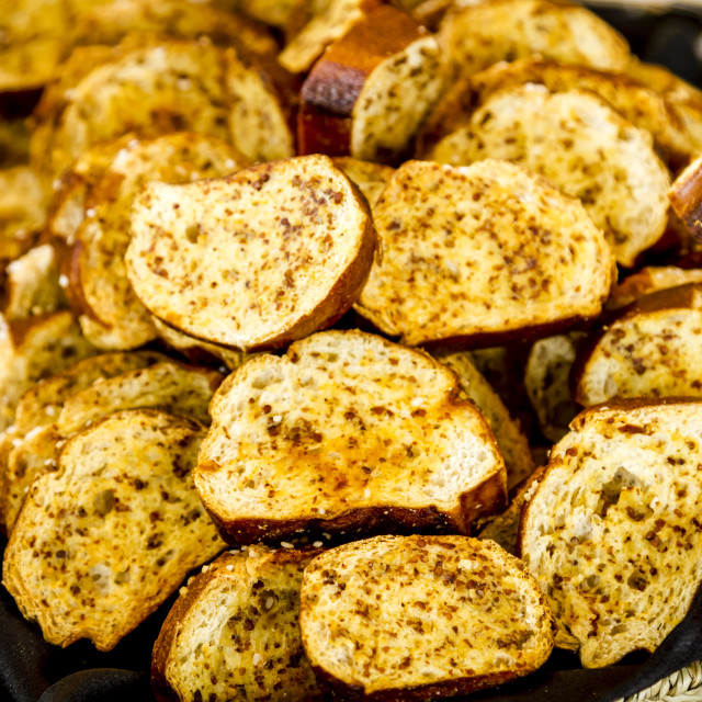 """Toasted herb bread slices"" stock image"