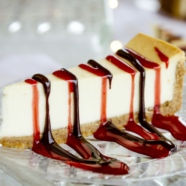 """Cheesecake slice with drizzled sauce"" stock image"