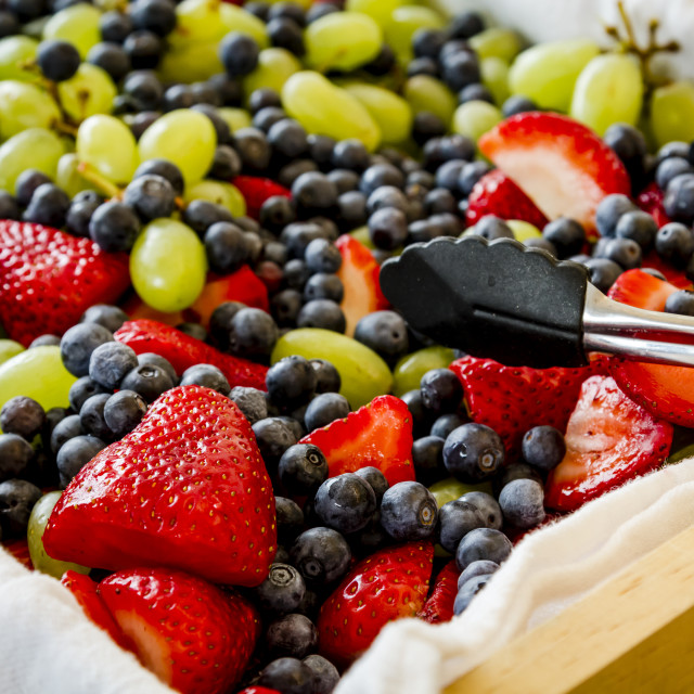 """Fresh fruit display at party"" stock image"