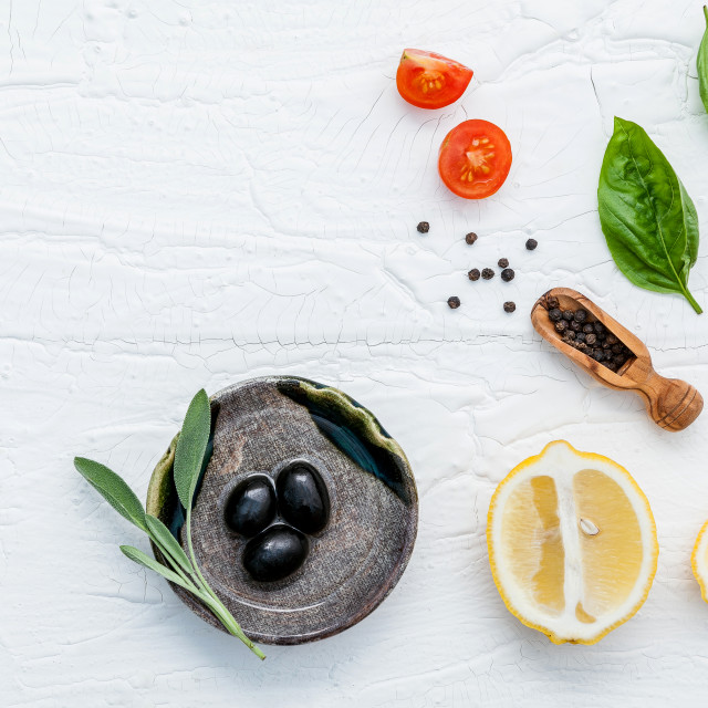 """Food background with fresh herbs tomato ,lemon slice , black pepper ,sage..."" stock image"