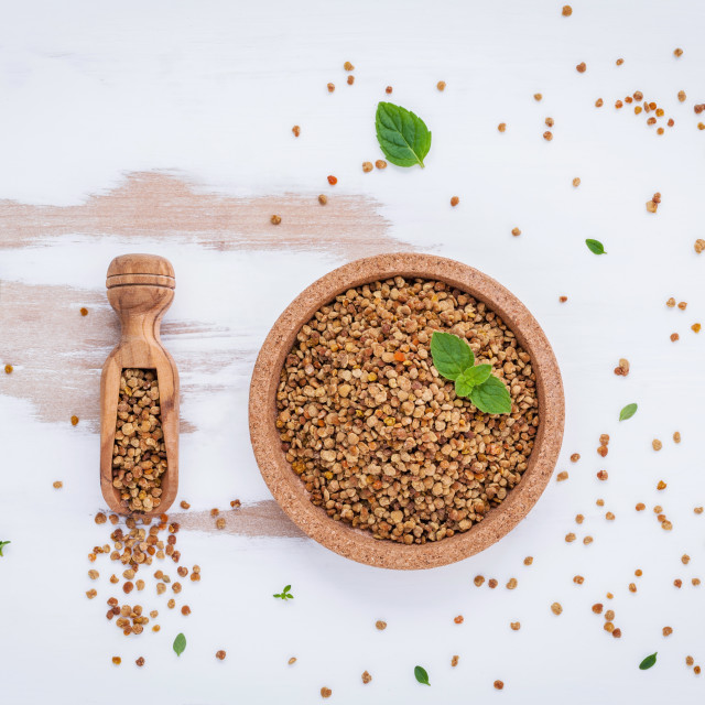 """Raw organic bee pollen on shabby wooden board. Bee pollen granules and..."" stock image"