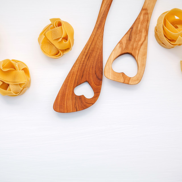 """Italian foods concept and menu design. Dried homemade Fettuccine with heart..."" stock image"