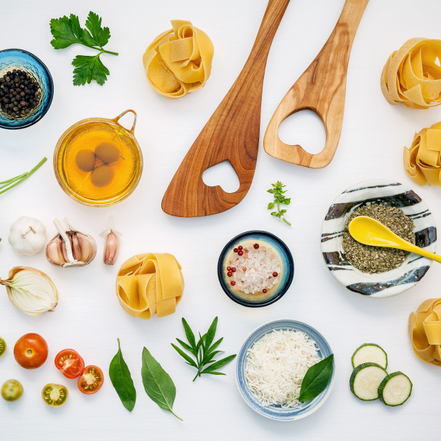 """Italian foods concept and menu design. Dried fettuccine with wooden spatula..."" stock image"