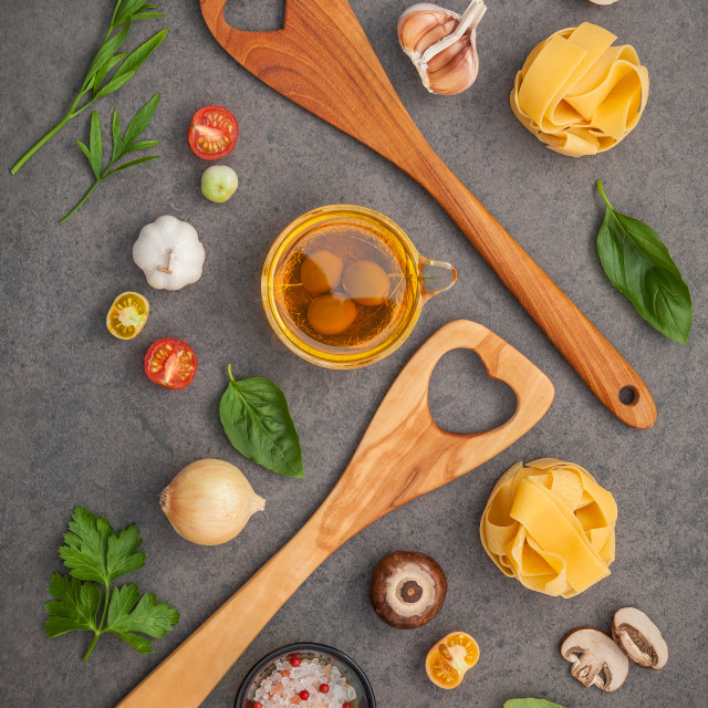 """Italian foods concept and menu design. Fettuccine with wooden spatula and..."" stock image"