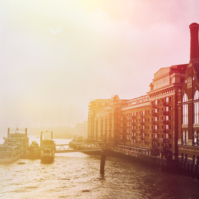 """Thames sunrise on a foggy morning"" stock image"