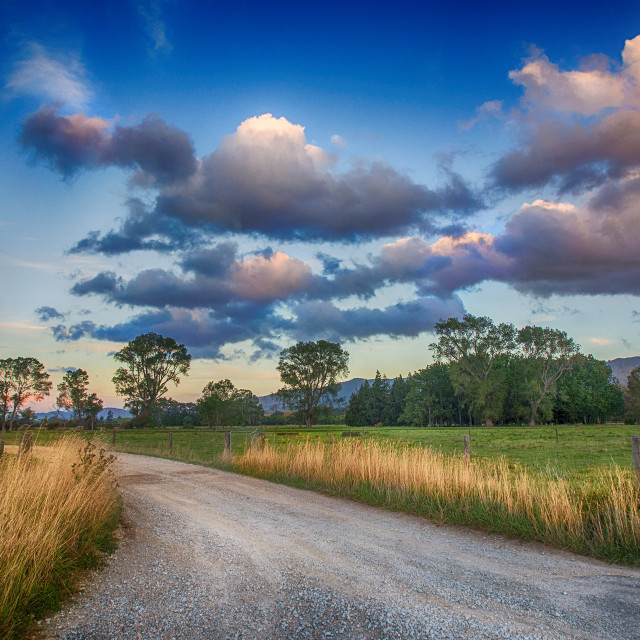 """Country road at sunrise"" stock image"