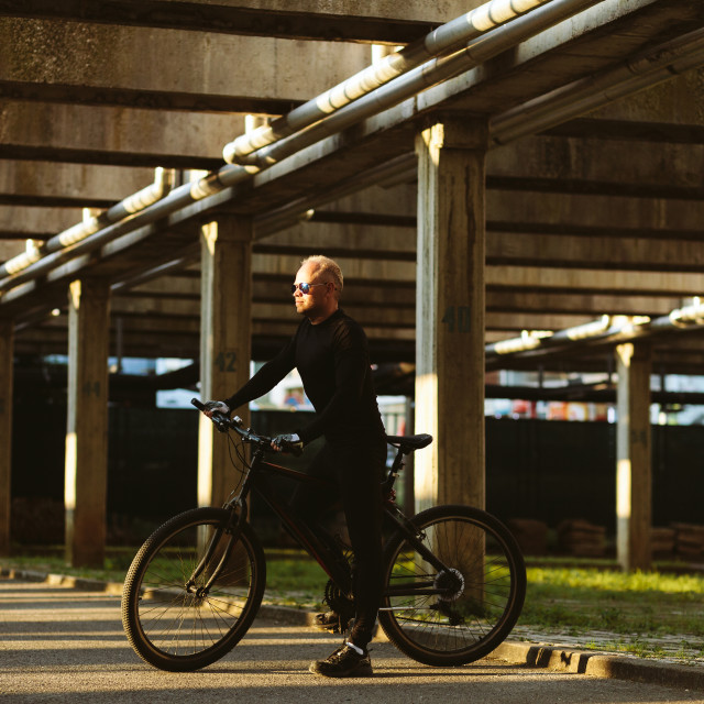 """bicycle style man in black sportswear"" stock image"
