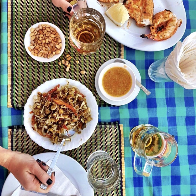 """Beachside lunch in Ngapali, Myanmar"" stock image"