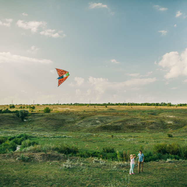"""lovely couple play with air kite at green meadow"" stock image"