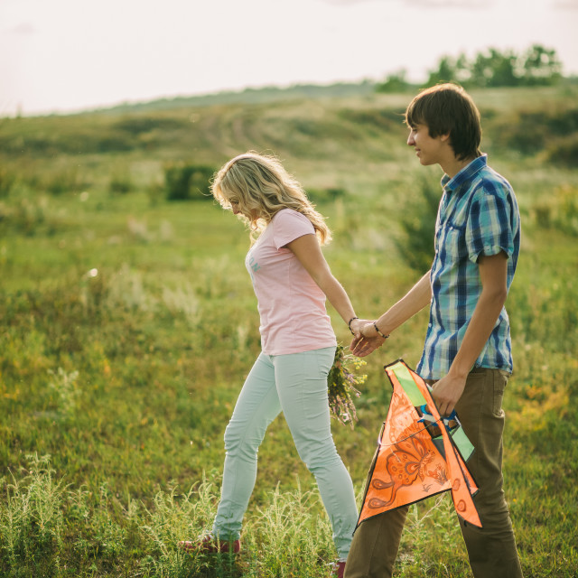 """lovely couple walk at green meadow"" stock image"
