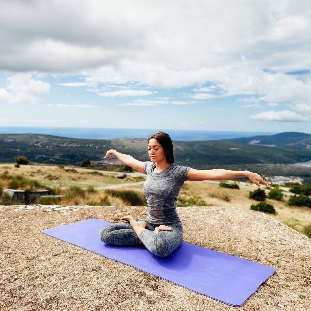 """woman yoga practice in mountains"" stock image"