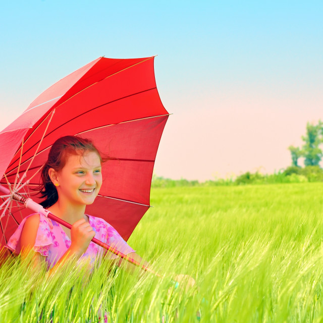 """""""Girl with umbrella at field"""" stock image"""
