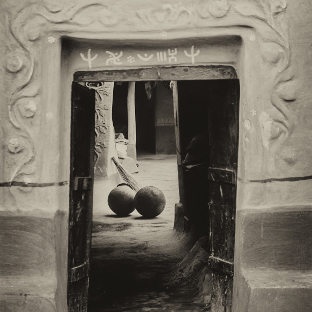"""A Santhal tribe village house, decorated doorway, two blackened"" stock image"
