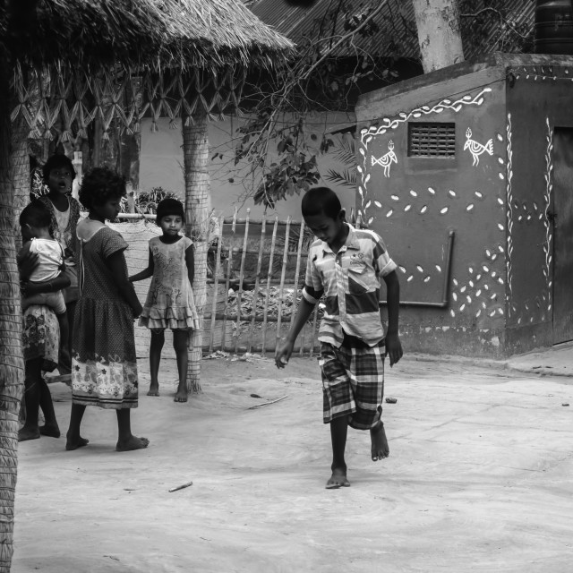 """Vilage boys and girls playing traditional games in the early mor"" stock image"