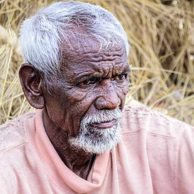 """Close up of tribal old man with white hair and beard with copy"" stock image"