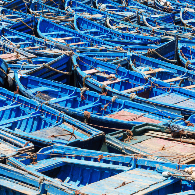 """Blue old wooden fishing boats in harbour"" stock image"
