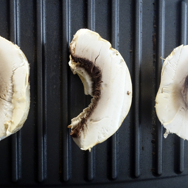 """Fresh Mushrooms Ready to be cooked on an Electric Griddle"" stock image"