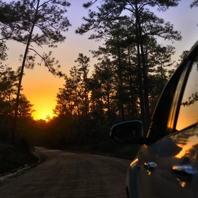"""Heading toward the setting sun"" stock image"