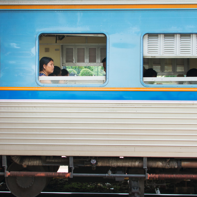 """""""People sitting in the third class in Hua hin train station in Thailand"""" stock image"""