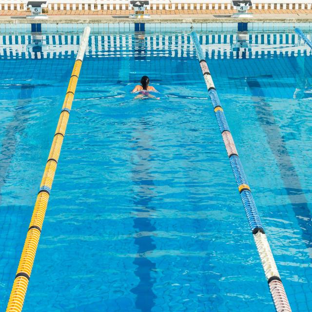 """Girl Swimming Gala Pool"" stock image"