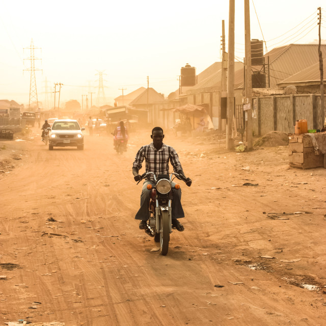 """Bike man in abuja nigeria"" stock image"