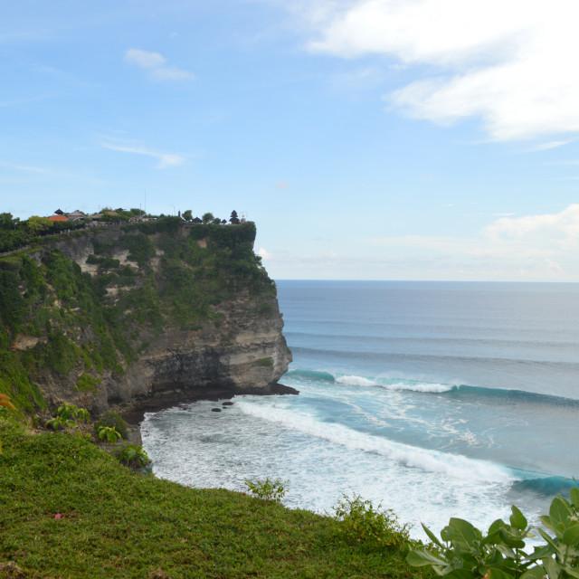 """""""Surfing at Uluwatu, Bali"""" stock image"""
