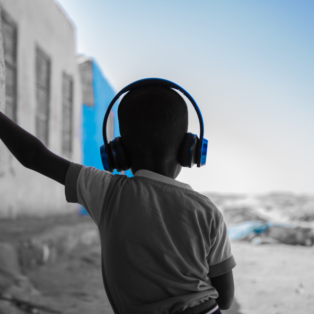 """A Nubian Boy Listening to Music"" stock image"