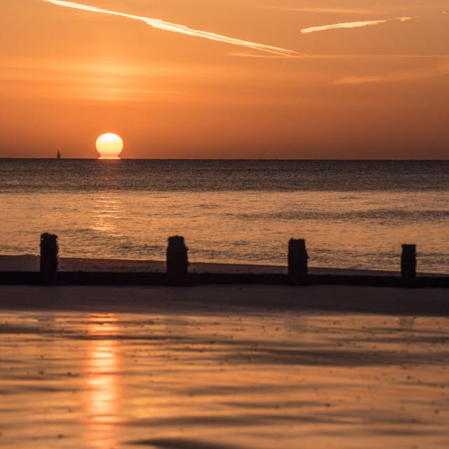 """Melting Sun Off Frinton Beach"" stock image"