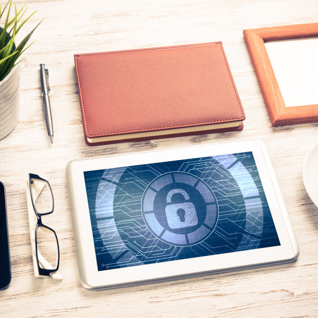 """""""Web security and technology concept with tablet pc on wooden tab"""" stock image"""
