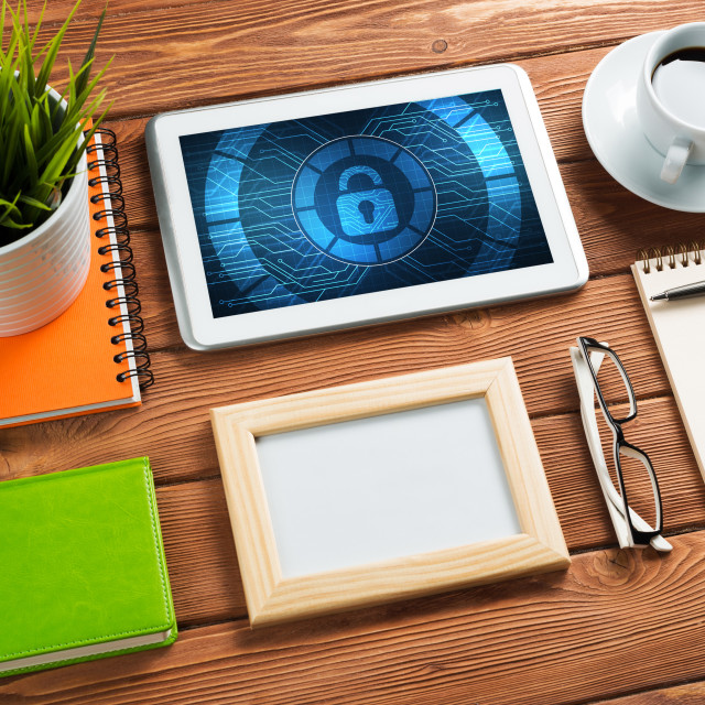 """""""Web security and technology concept with tablet pc on wooden table"""" stock image"""
