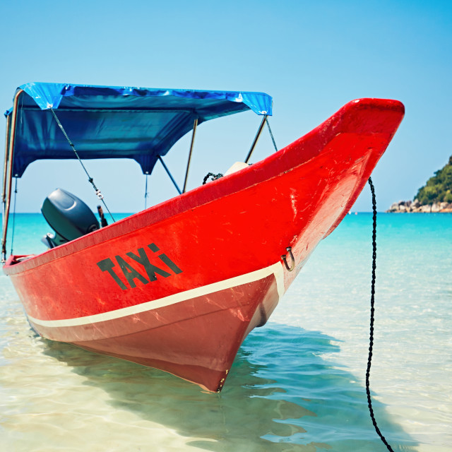 """Boat taxi on the tropical beach. Perhetian islands, Malaysia"" stock image"