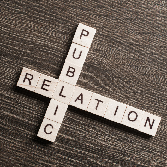"""""""Public Relation crossword on office table collected of wooden cubes"""" stock image"""