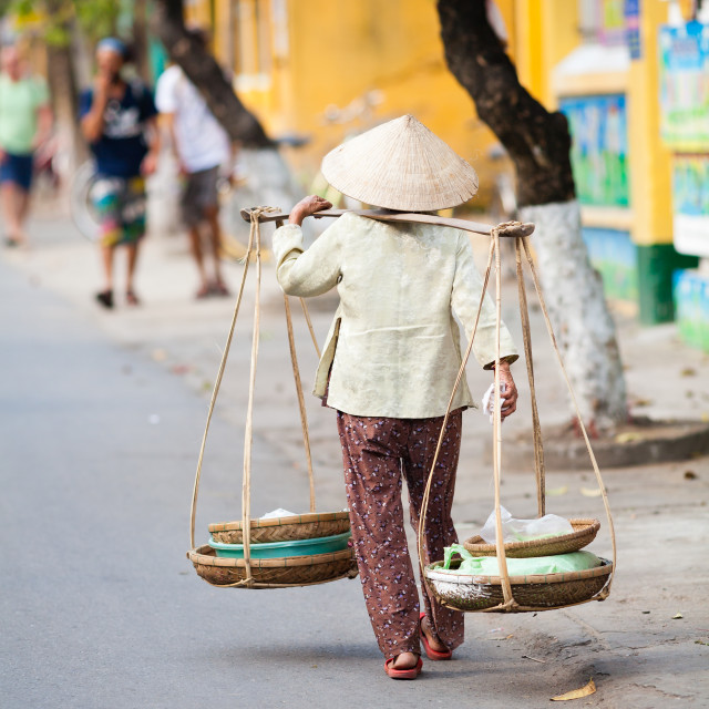 """""""Vietnamese woman is carrying goods in traditional way"""" stock image"""