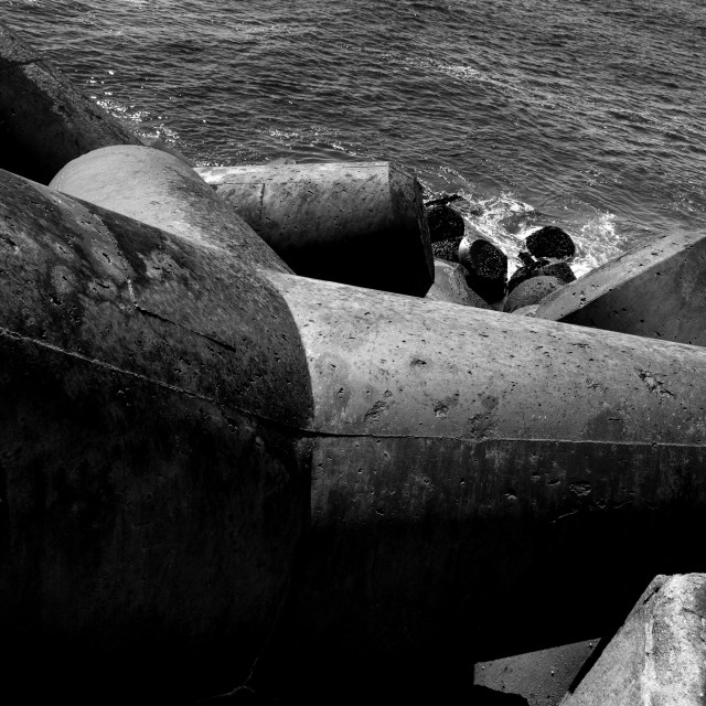 """Concrete blocks in the edge of a pontoon"" stock image"