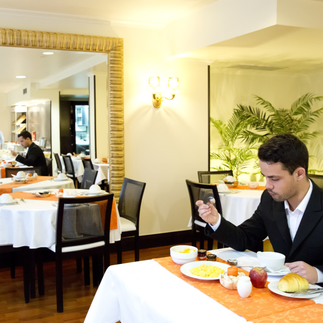 """Businessman takes breakfast in hotel"" stock image"