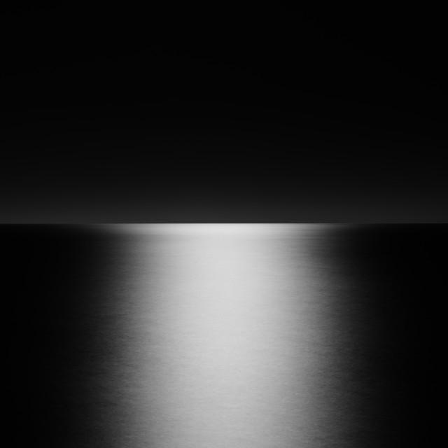 """moonlight on sea, mono"" stock image"