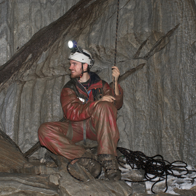 """""""Caving in wet cave"""" stock image"""