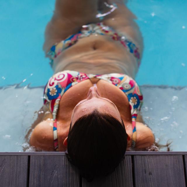 """Relaxing in a swimmingpool"" stock image"