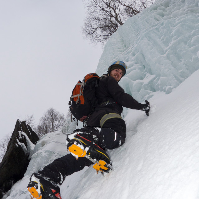 """Ice-climbing a frozen waterfall"" stock image"