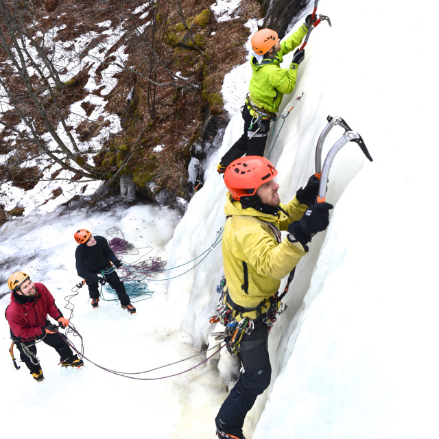 """""""Men climbing ice with colorful gear"""" stock image"""