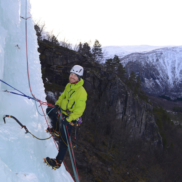 """Ice-climbing a frozen waterfall"" stock image"