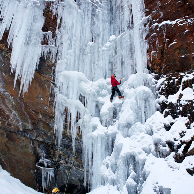 """Man climbing ice"" stock image"