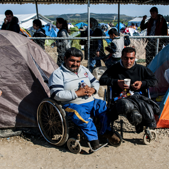 """""""Syrian refugees in the camp set to Disabled Idomeni in Greece on the border with Macedonia"""" stock image"""