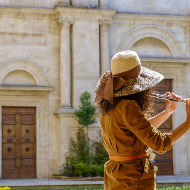 """Musician playing in front of the Cathedral of Pienza Tuscany"" stock image"