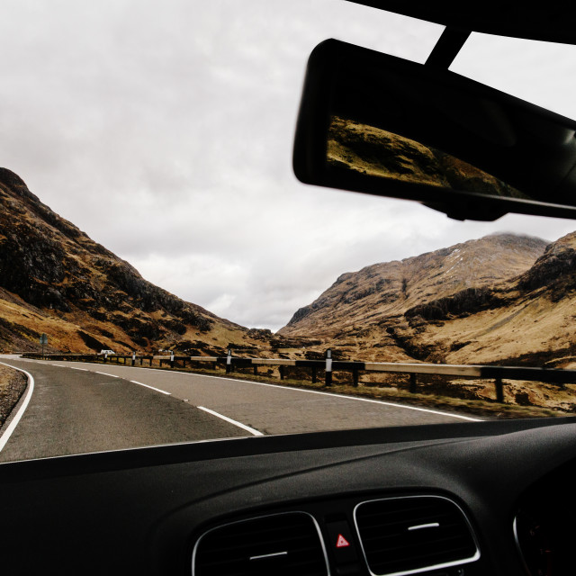 """Car driving through Glencoe, Scotland. Scottish Highlands."" stock image"