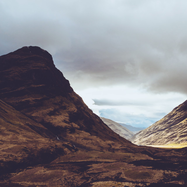 """Glencoe Valley on cloudy moody day in Scotland. Scottish Highlan"" stock image"