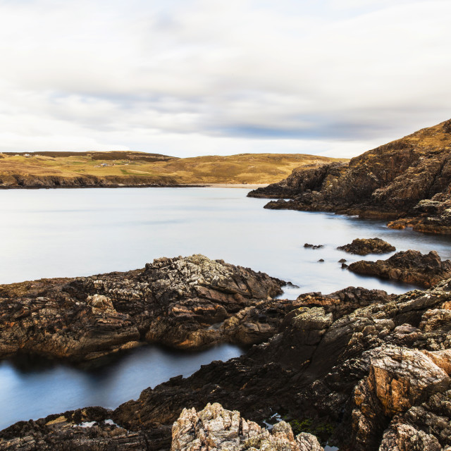 """Rocks on the coast at Farr Bay beach in Sutherland, Scotland."" stock image"