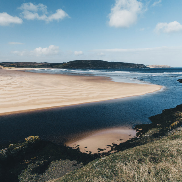 """Sandy beach with blue sky at Bettyhill, Sutherland, Scotland."" stock image"