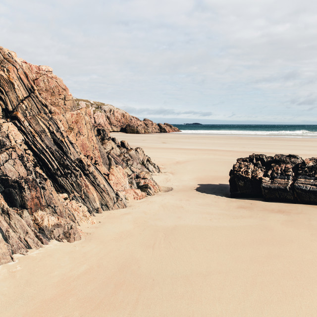 """Rocks on sandy beach at Durness, Sutherland, Scotland."" stock image"